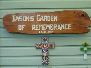 The sign Jason`s Grandpa made for the garden