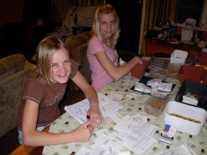 Jade and Kyla at work packing seeds for the Memory Garden